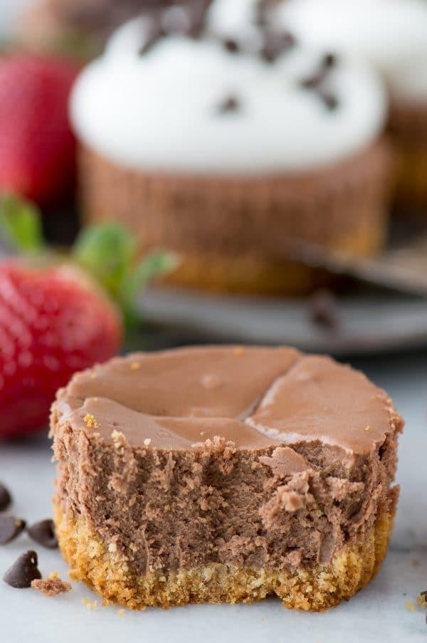 mini chocolate cheesecake with bite on white background
