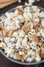 The easiest S'mores Popcorn recipe with 5 ingredients! Plus a whole list of fun add-ins to make it extra s'more-y!!