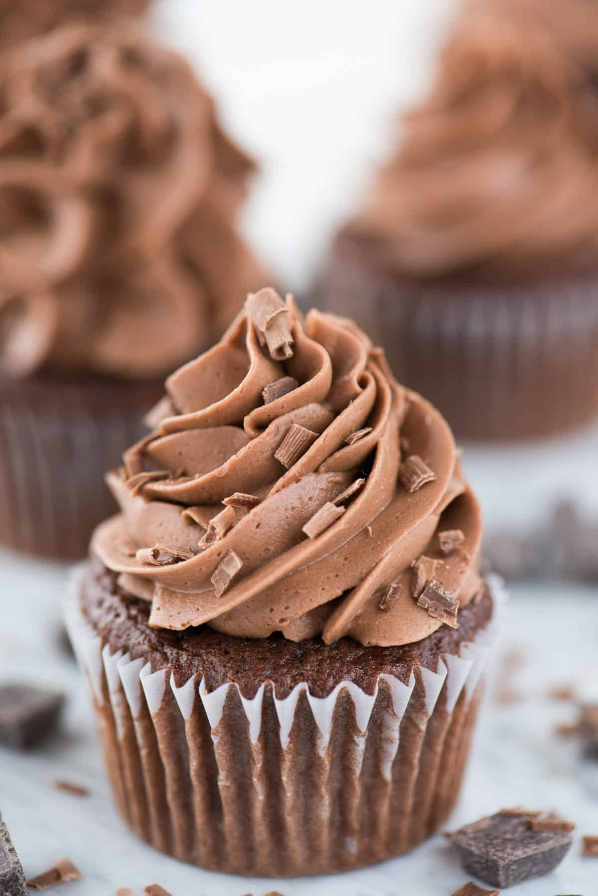 chocolate cupcake with chocolate frosting on white background