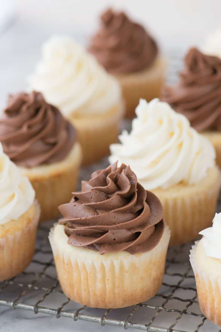 This CLASSIC WHITE CUPCAKE recipe is AMAZING! This is our go-to white cupcake recipe because it's so moist and flavorful. Pair these cupcakes with vanilla or chocolate frosting. This is our go to moist white cupcake recipe to make for a wedding, baby shower, or any party.