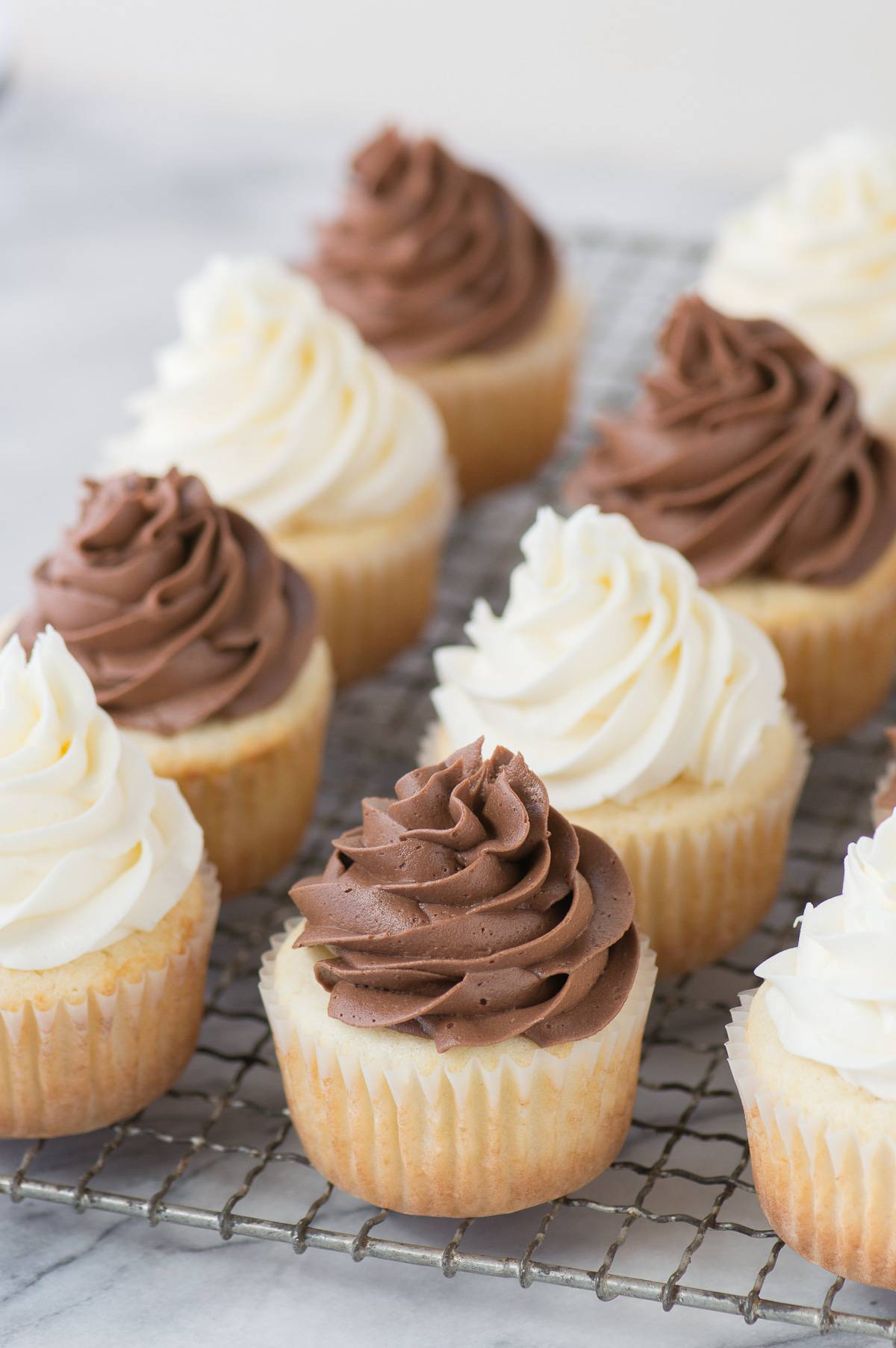 This CLASSIC WHITE CUPCAKE recipe is AMAZING! This is our go-to white cupcake recipe because it's so moist and flavorful. Pair these cupcakes with vanilla or chocolate buttercream.