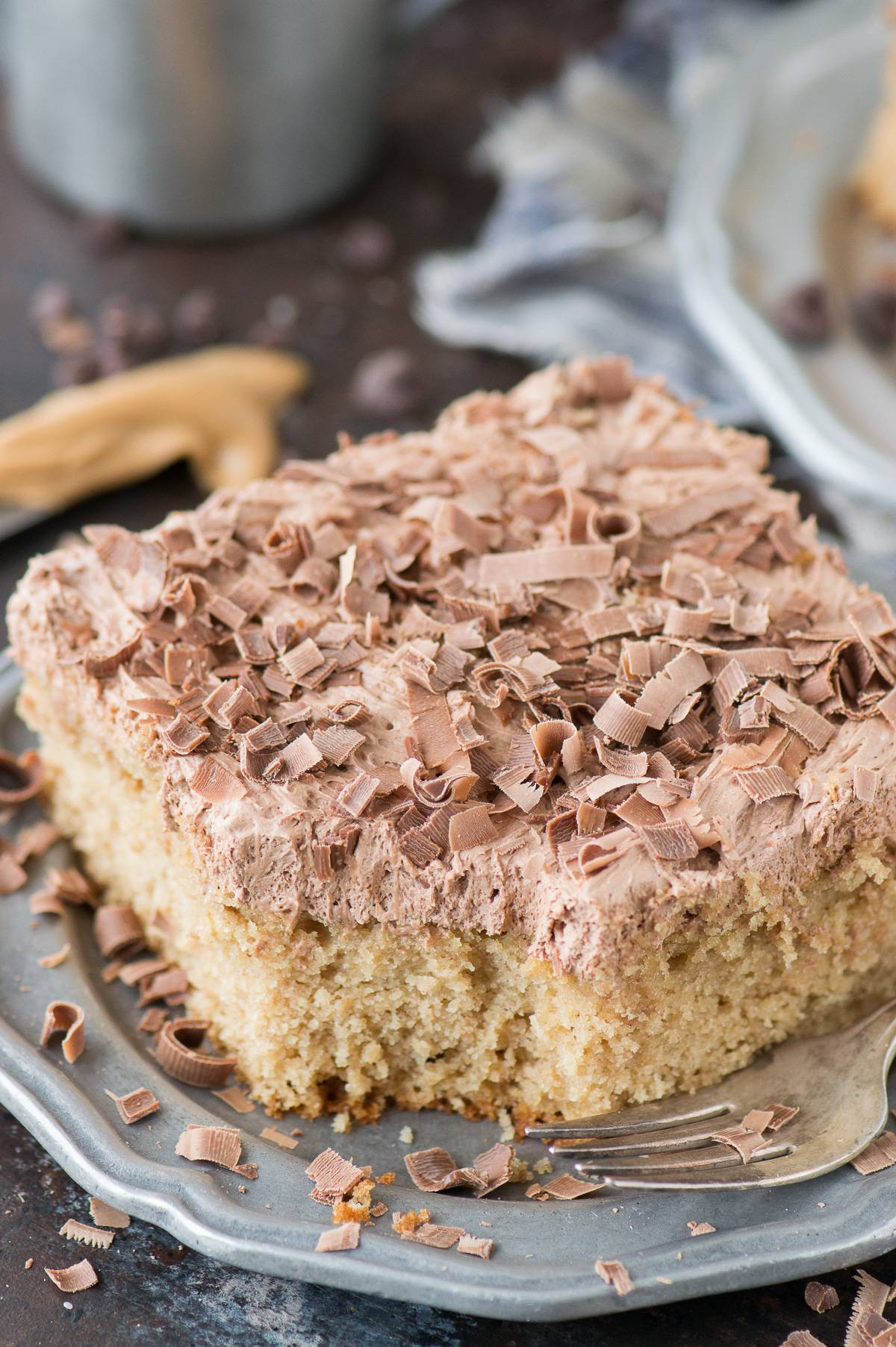 From scratch moist and peanut buttery PEANUT BUTTER SHEET CAKE! Pair this cake with chocolate frosting!