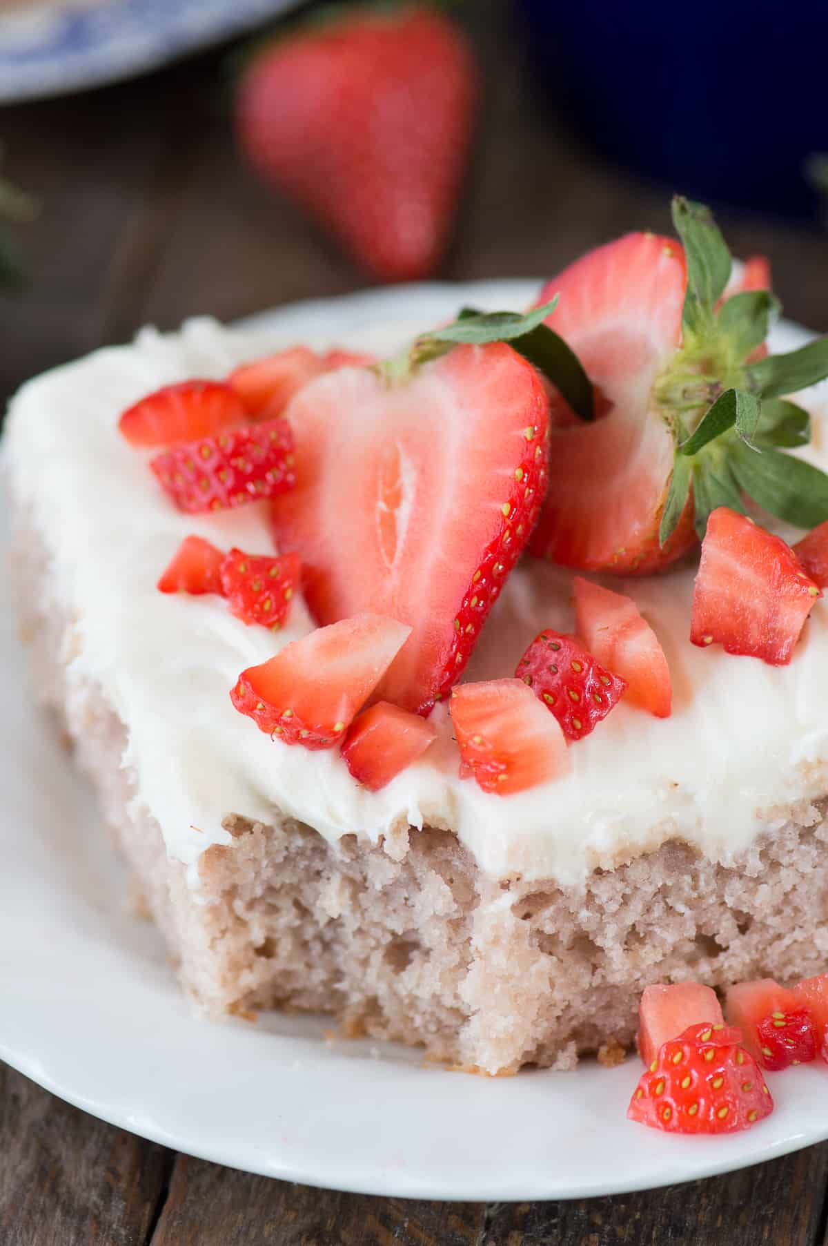 From scratch 9x13 inch fresh strawberry cake with cream cheese frosting! Uses real strawberries and strawberry yogurt.