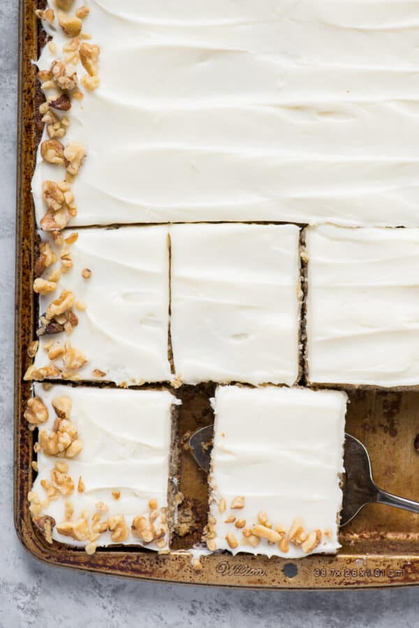 banana bars with cream cheese frosting and walnuts in sheet pan