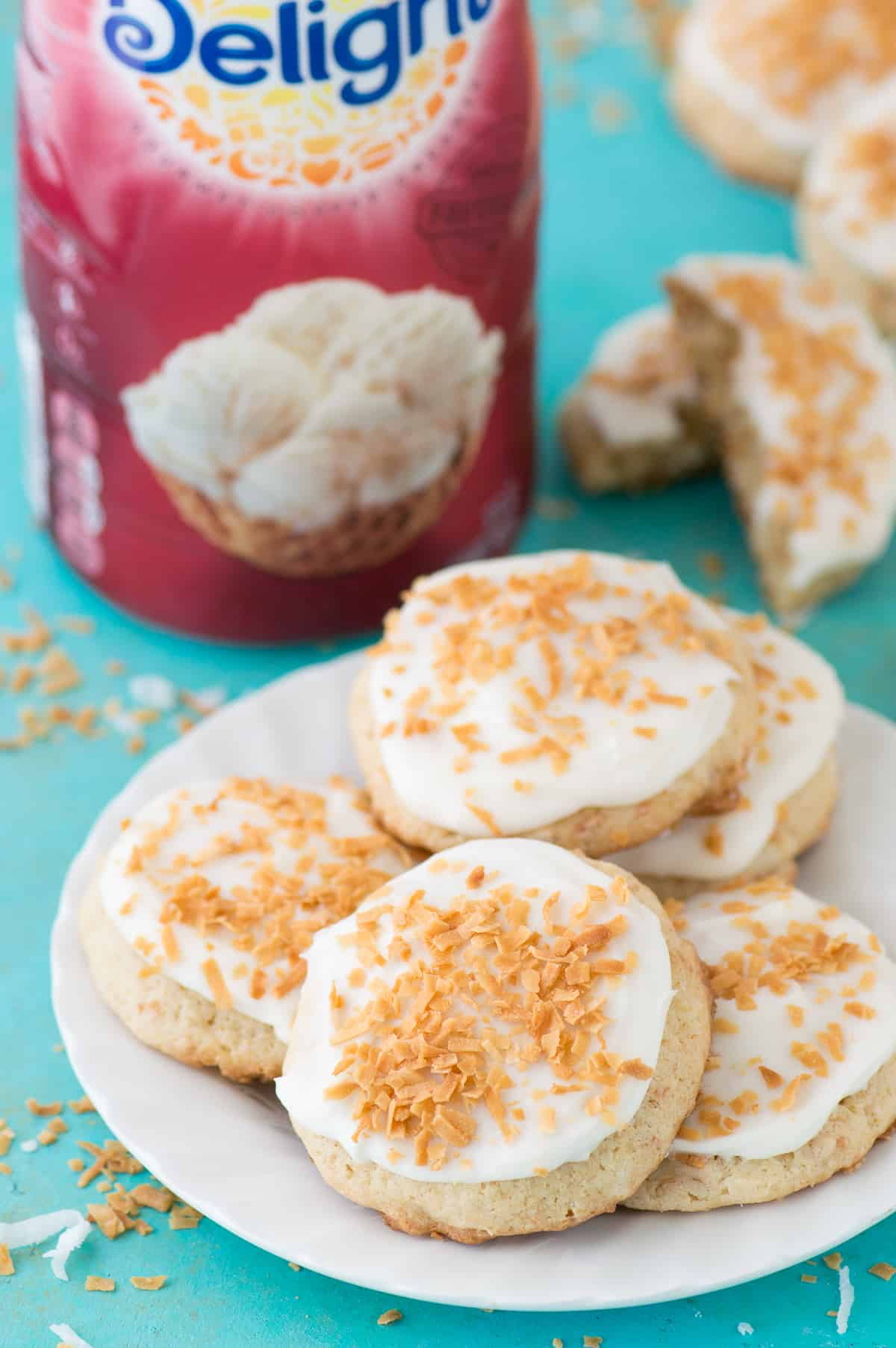 Soft and pillowy coconut cookies with shredded coconut, toasted coconut, and coconut extract! Even if you aren't a coconut lover, you'll enjoy these!