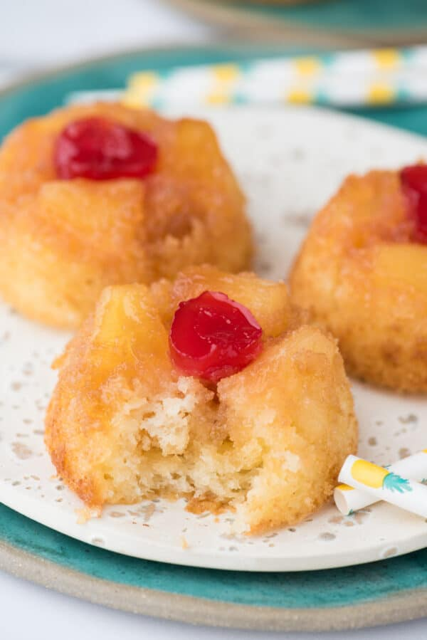 mini pineapple upside down cupcakes on white plate