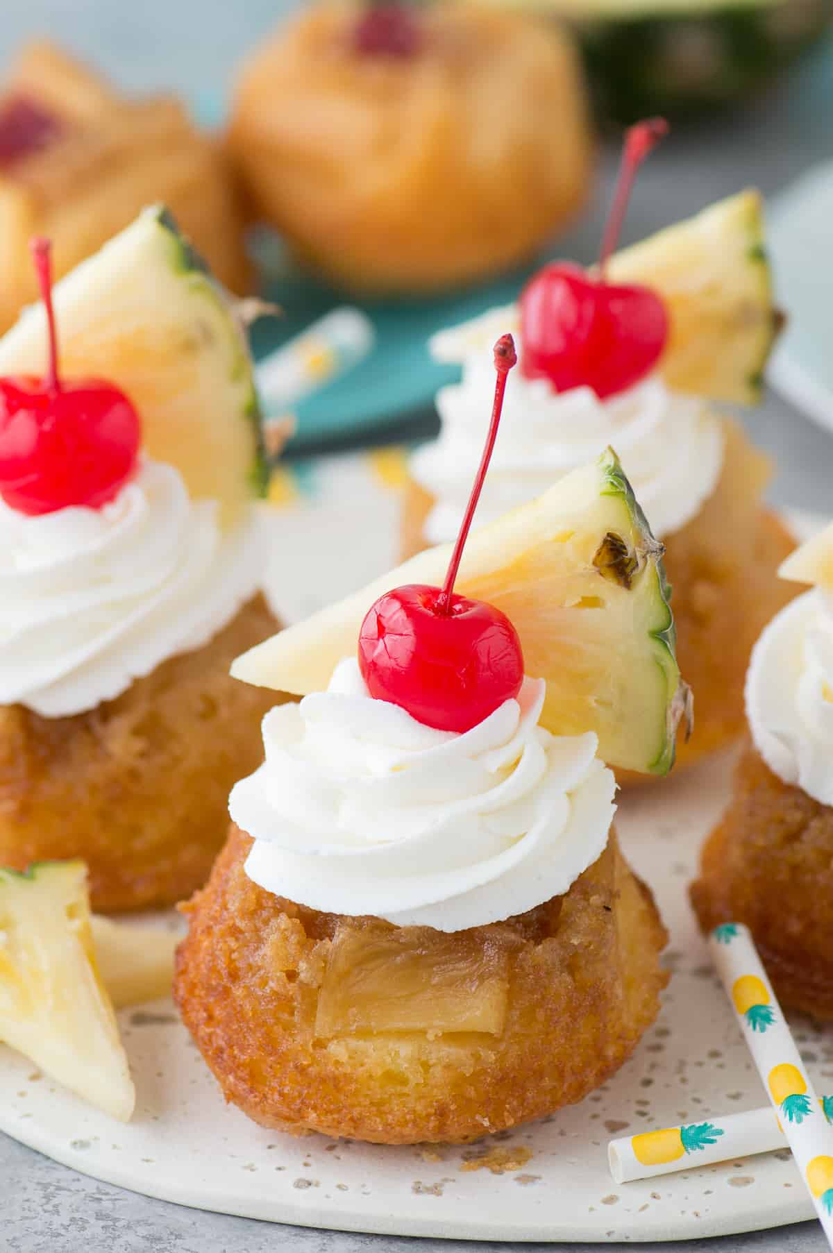The BEST 7 ingredient mini pineapple upside down cakes! The cakes are so moist and I LOVE the presentation with the garnishes!