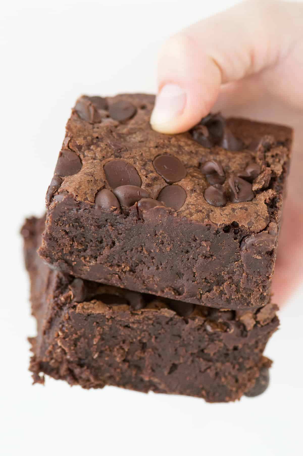 These SUPER FUDGY BROWNIES are a family favorite and loaded with 3 kinds of chocolate. Not your average brownies, these are dense and super chocolatey!