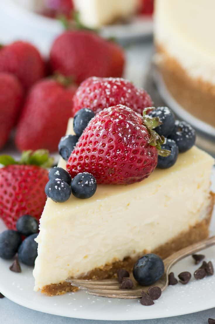 A classic plain cheesecake recipe with a graham cracker crust. Impress guests every time you make this Philadelphia style cheesecake. #plaincheesecake #classiccheesecake #philadelphiacheesecake