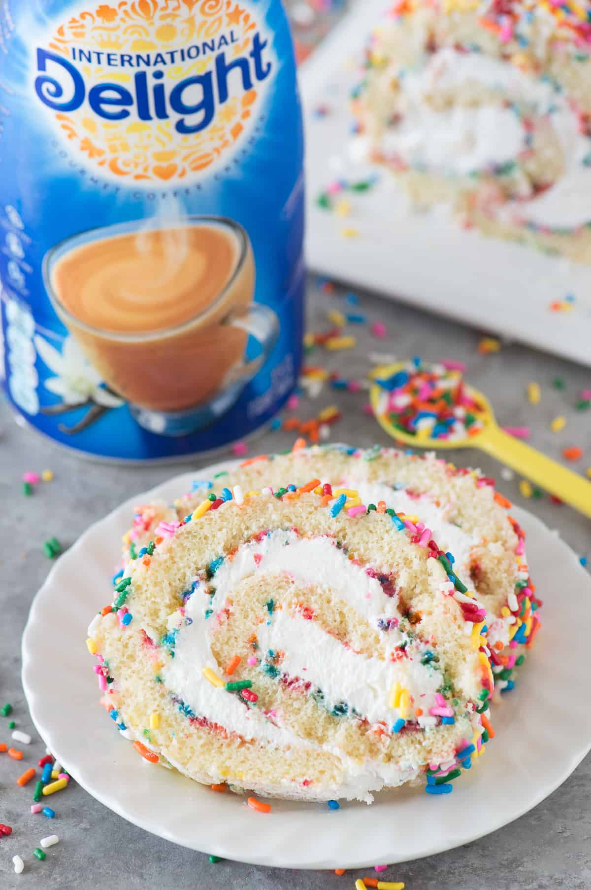 The ULTIMATE funfetti cake roll! A vanilla cake paired with a cream cheese frosting. Add as many sprinkles as you like! #Idelight
