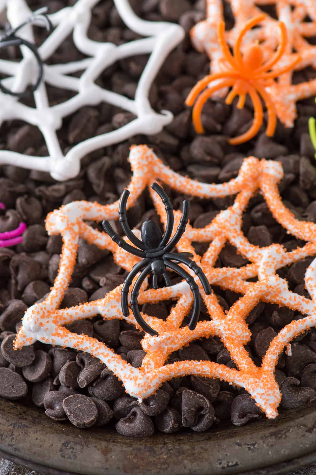An easy Halloween treat - edible spider web meringues! Display these spider webs with plastic spider rings for a spooky look!