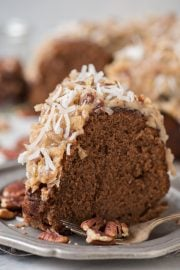 Rich and chocolatey german chocolate bundt cake with classic german chocolate frosting! We'll show you how to make that classic coconut pecan frosting!