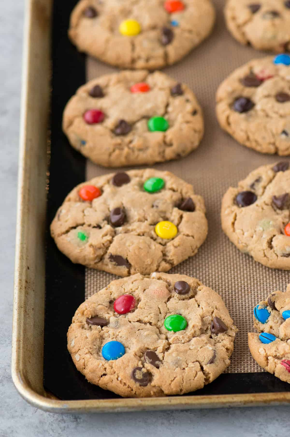 Classic monster cookies with oatmeal, chocolate chips, and m&ms! Plus lots of ideas for additional add-ins! These are chewy & soft and you can make them BIG or small!