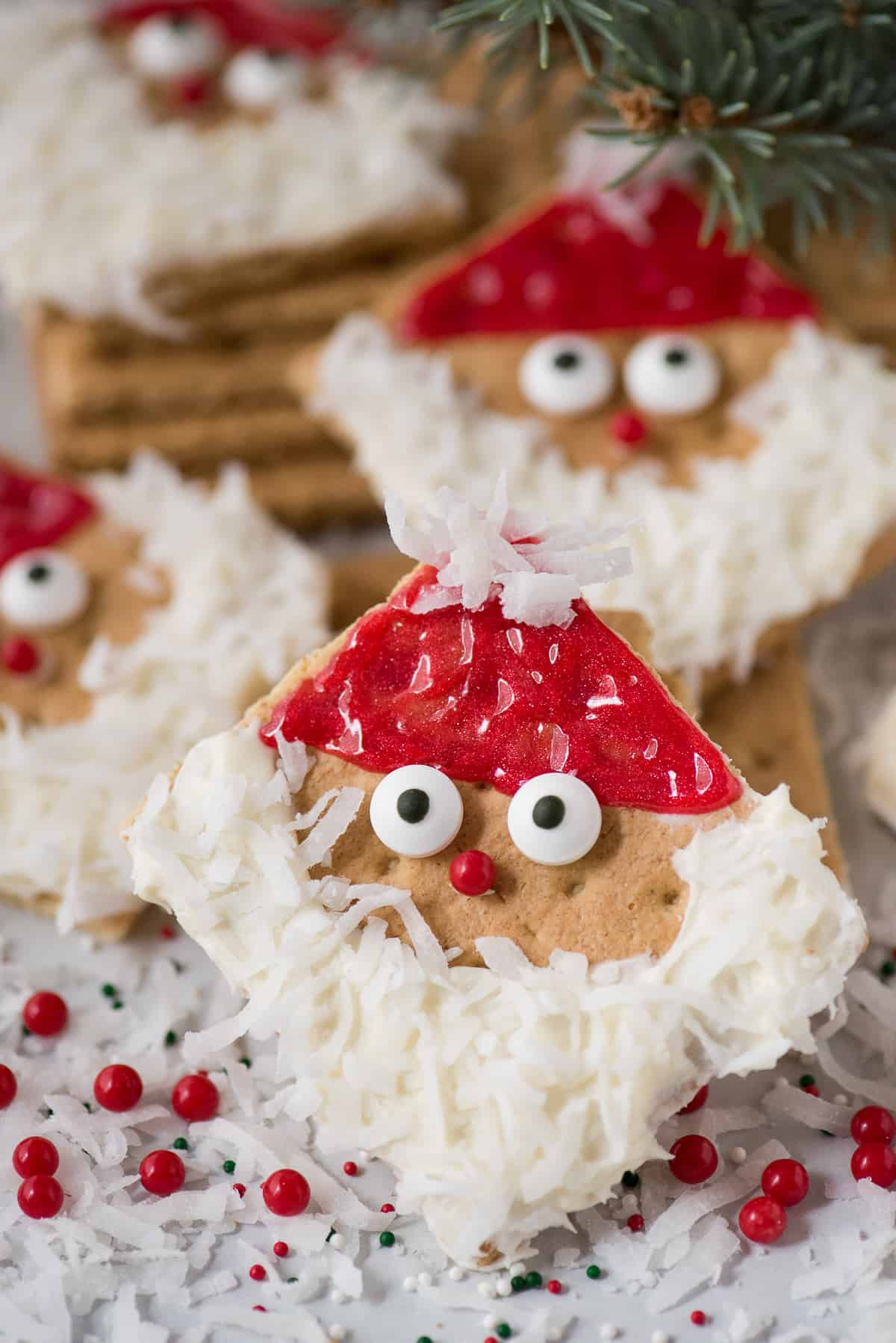 Easy to make Santa Graham Crackers are the perfect edible treat to make at home with your kids or at a school Christmas party! You can buy all the supplies at the grocery store, ZERO prep involved!