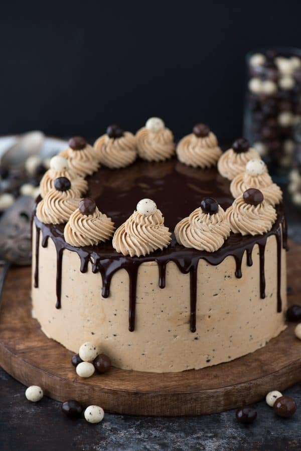 chocolate espresso cake with chocolate covered coffee beans on wood platter