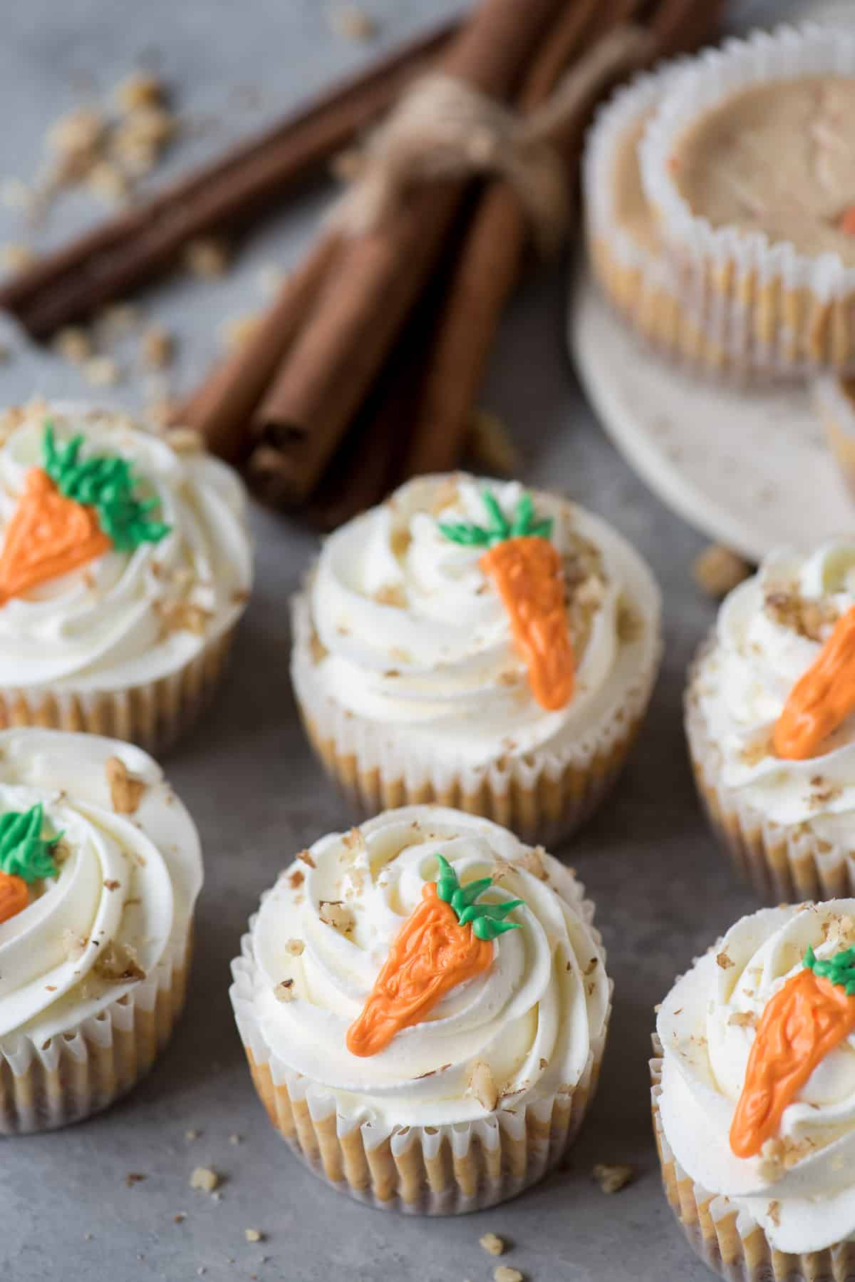 mini carrot cheesecakes with frosting carrot on top