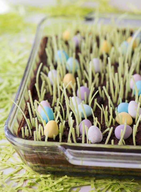 Egg Hunt Sugar Cookie Bars with edible grass in glass pan