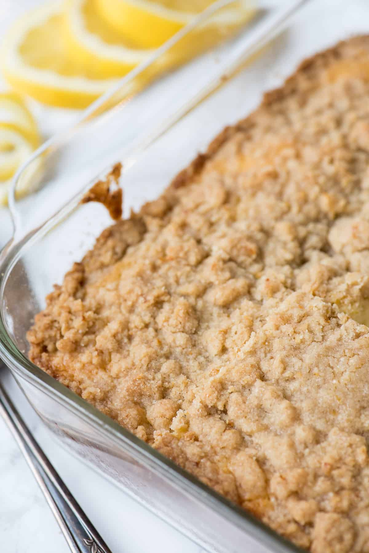 lemon crumb cake in clear baking dish