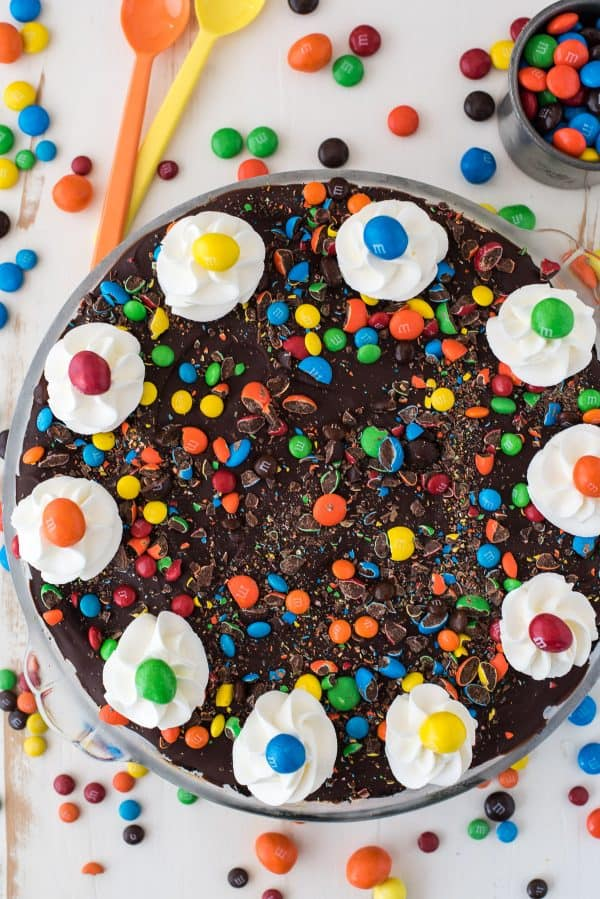 aerial view of m&m pie with chocolate topping and crushed m&ms