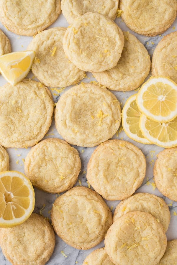 aerial view of lemon cookies on white background with lemon slices