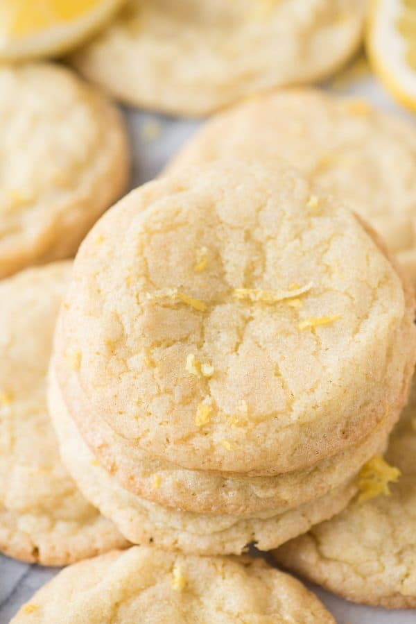 a stack of 3 lemon cookies with lemon zest on top
