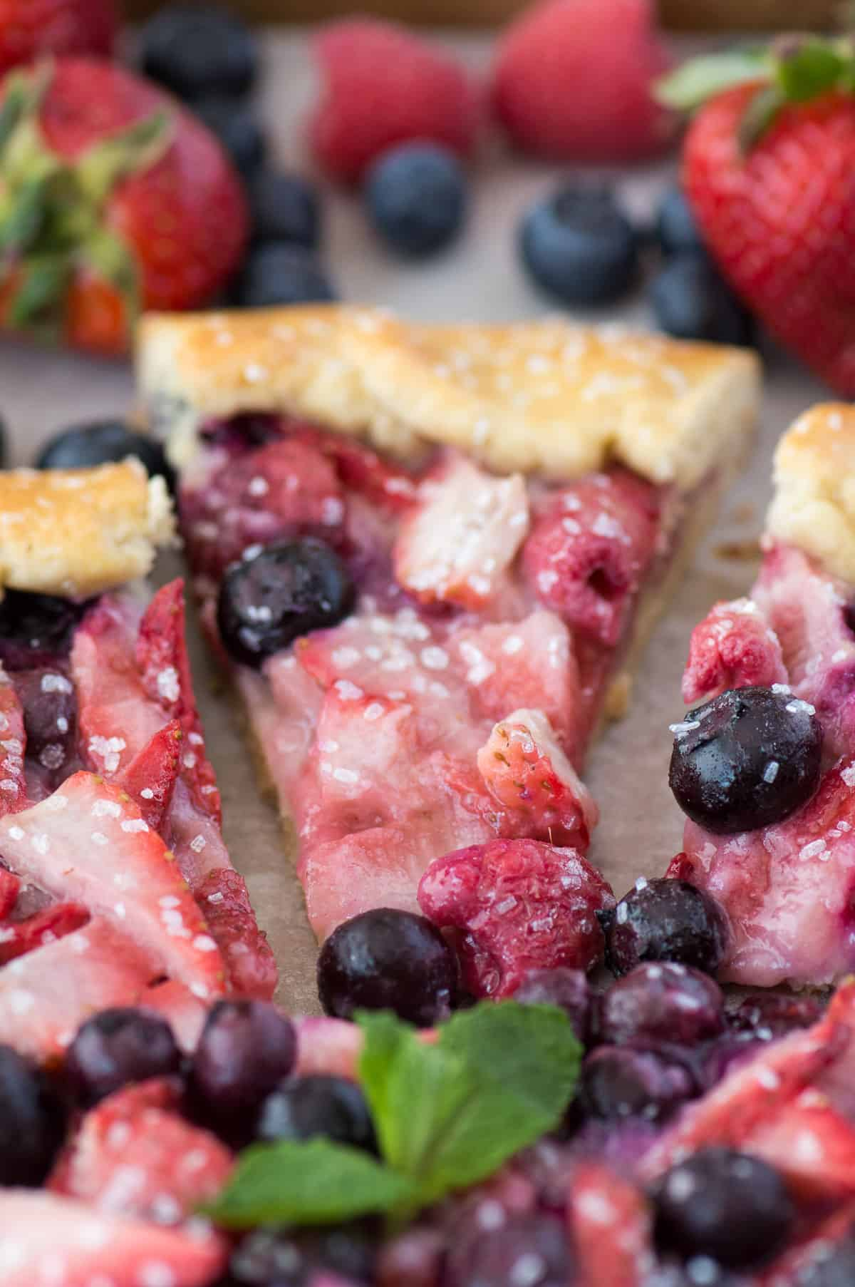 close up of slice of mixed berry galette