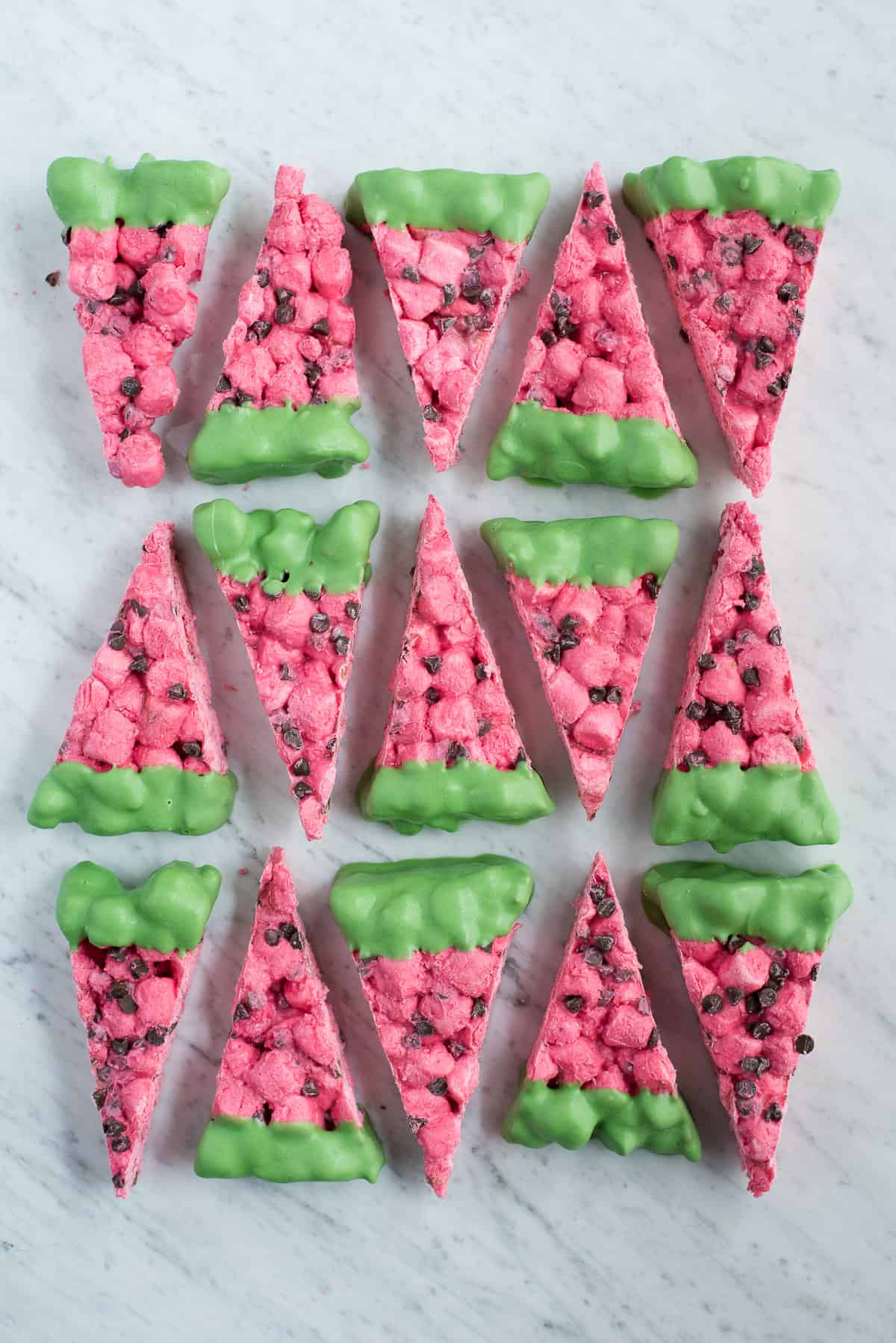 pink and green watermelon marshmallow slices on marble background