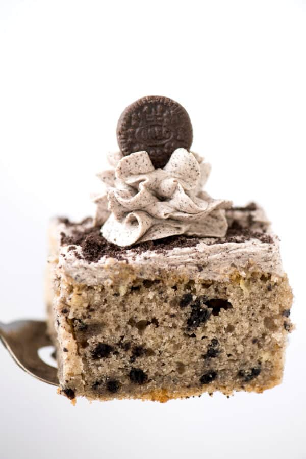 slice of oreo cake with oreo frosting on metal spatula