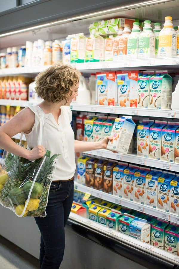 woman shopping for brand product in a grocery store