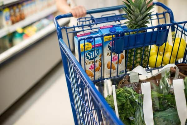 woman with shopping cart in a grocery store