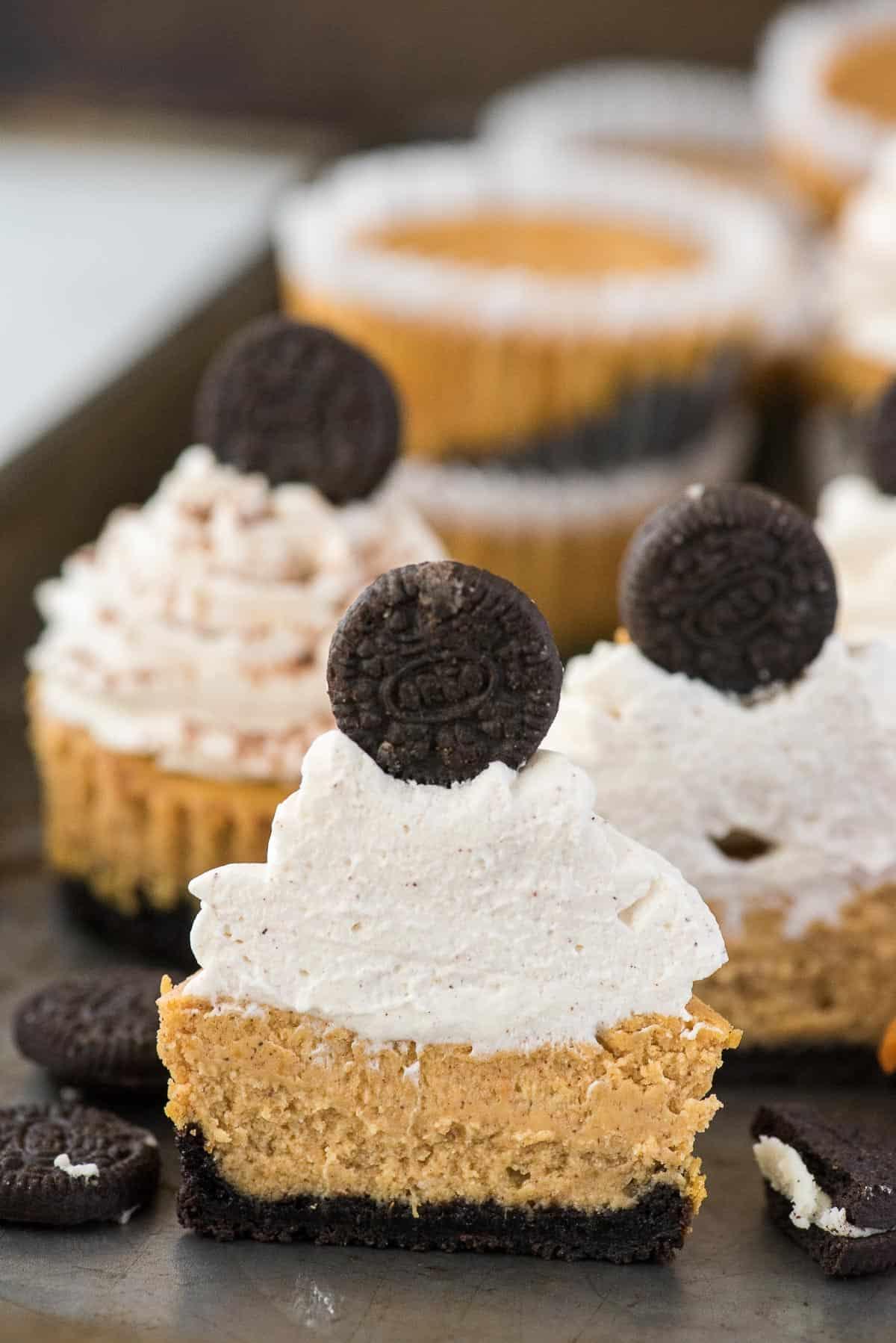 mini pumpkin cheesecake with oreo cookie crust cut in half