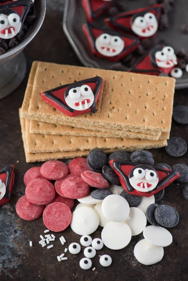 supplies to make edible vampire treats including graham crackers, red, white and black candy melts, and candy eye balls