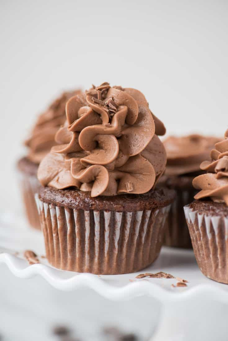 "Bakery style ""doctored up"" chocolate cupcakes! This is an easy, one bowl chocolate cake mix cupcake recipe without pudding or coffee."