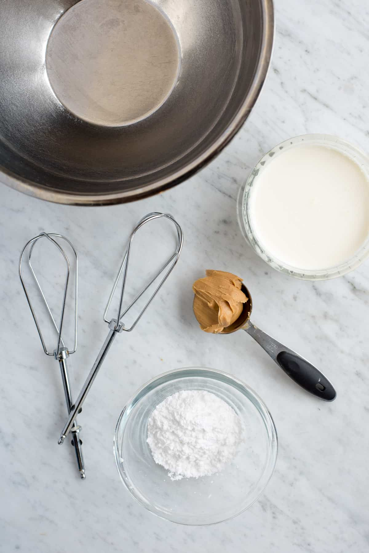 metal mixing bowl, beaters, heavy cream, peanut butter and powdered sugar