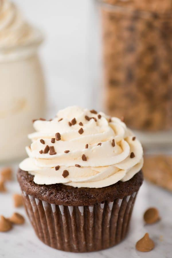 peanut butter whipped cream on top of chocolate cupcake