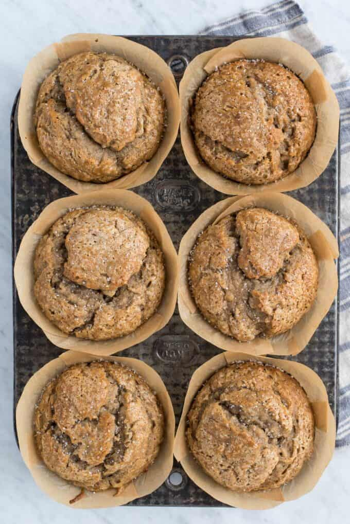 banana muffins in metal muffin tin on white background