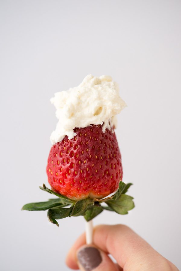 cheesecake whipped cream on top of strawberry