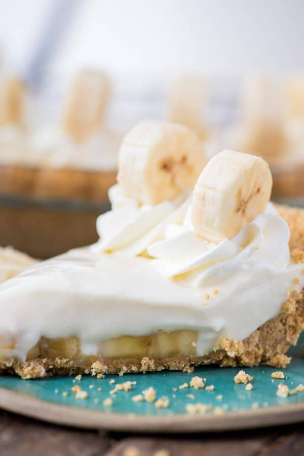 slice of banana breeze pie on teal plate