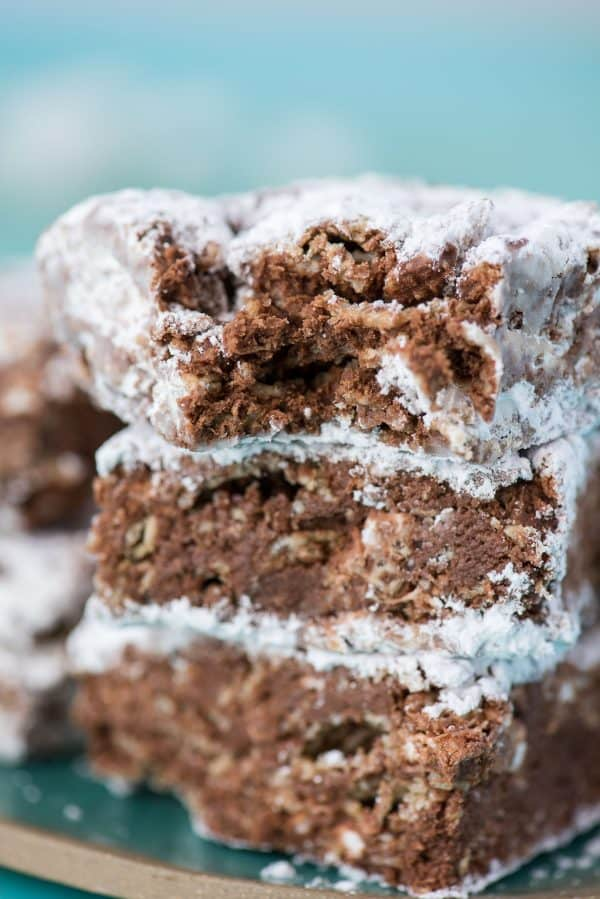 three puppy chow bars stacked on top of each other with teal background