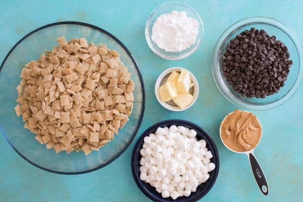 puppy chow bar ingredients in bowls on teal background