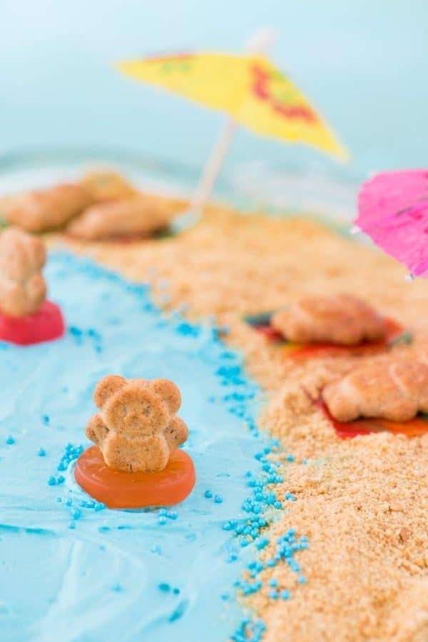 beach theme cake, teddy graham in gummy life saver swimming