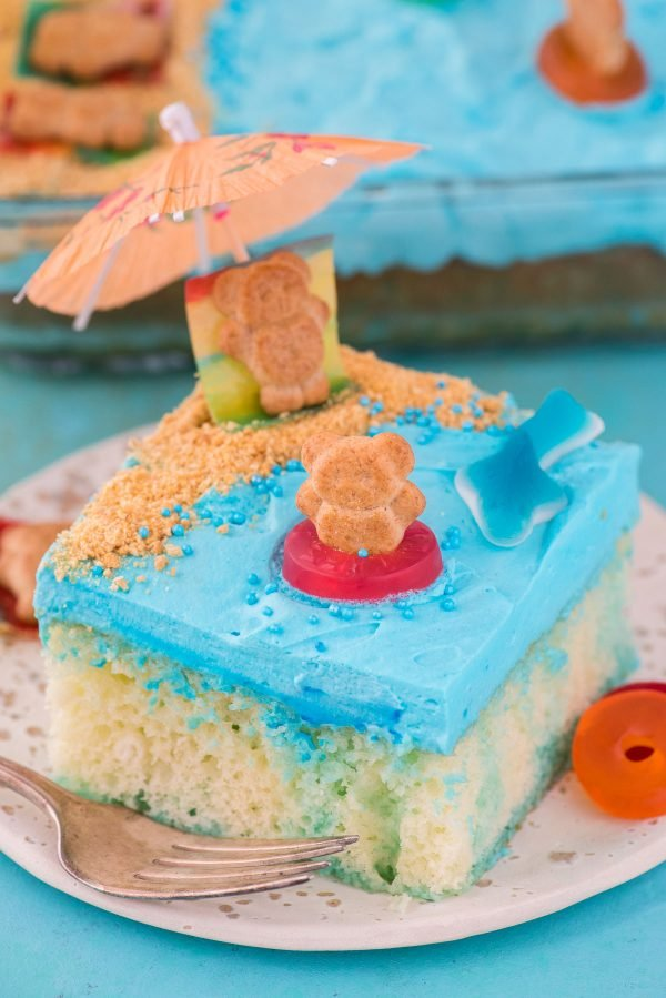 slice of beach theme cake on white plate