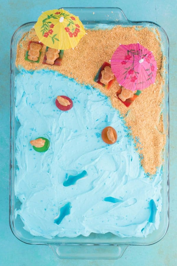 Aerial photograph of beach theme cake on blue background