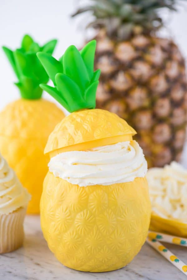 pineapple whipped cream in plastic pineapple cup