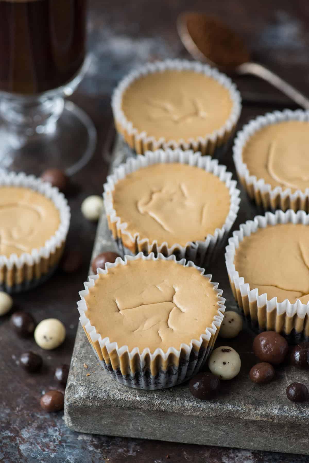 mini coffee cheesecakes on stone slab with espresso beans