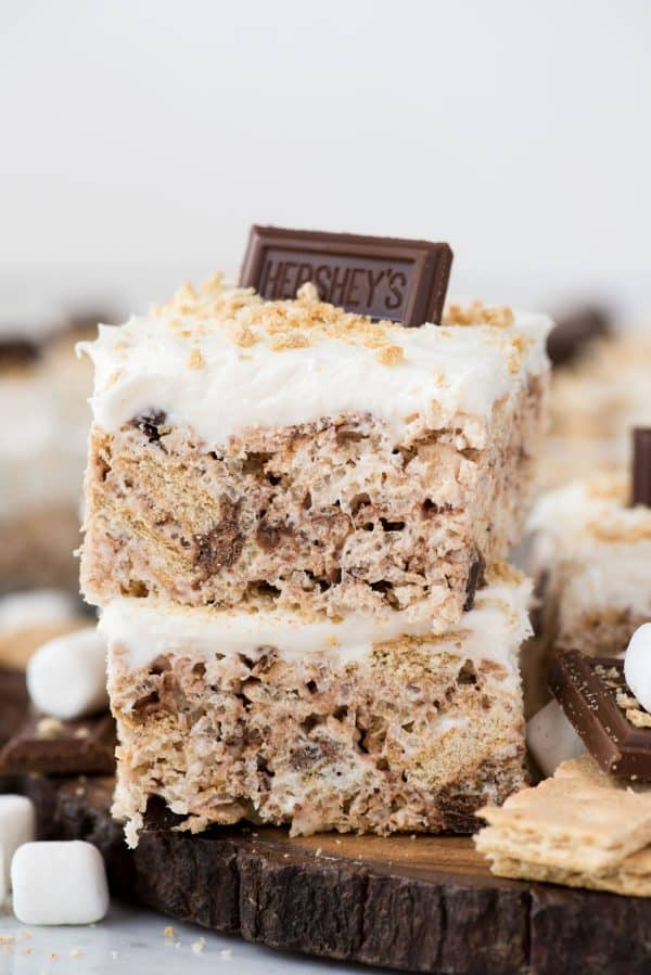 Two s'mores rice krispie treats cut into squares and stacked on top of each other