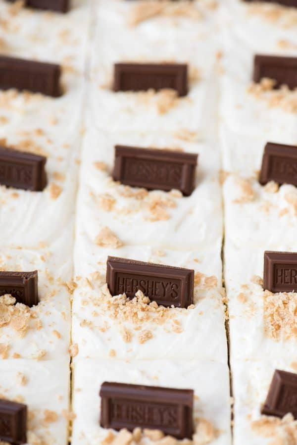 S'mores bars with marshmallow frosting and hershey's chocolate bars in glass 9x13 inch pan