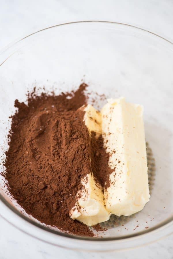 cocoa powder and butter in glass bowl