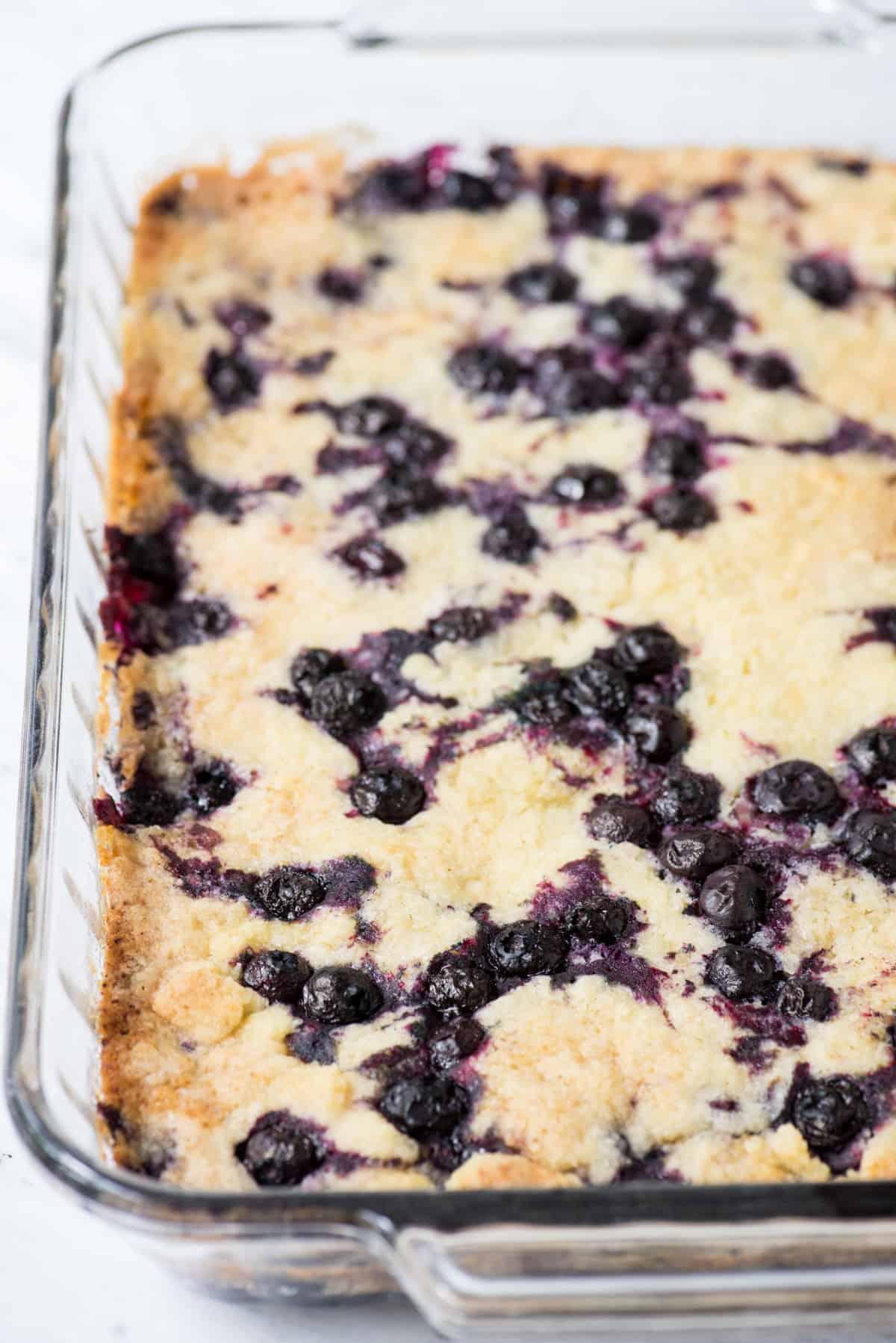 lemon blueberry dump cake in glass 9x13 inch pan