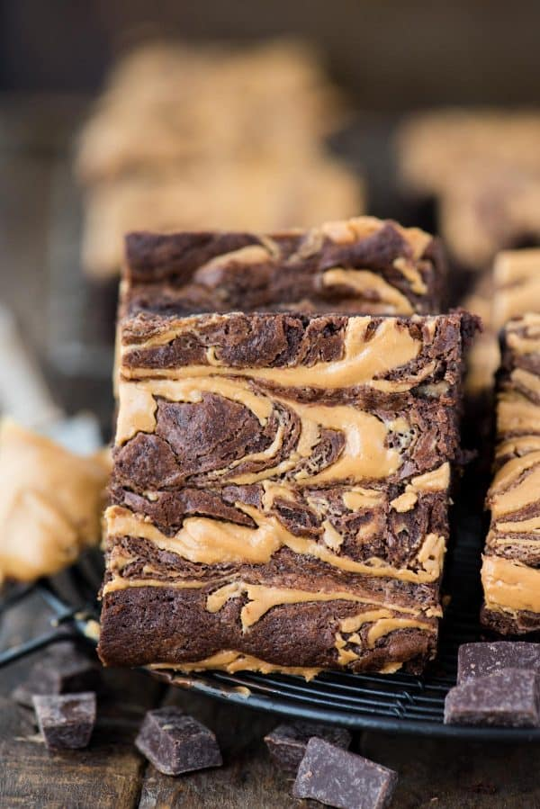 peanut butter swirl brownie slice on black wire trivet with chocolate chucks